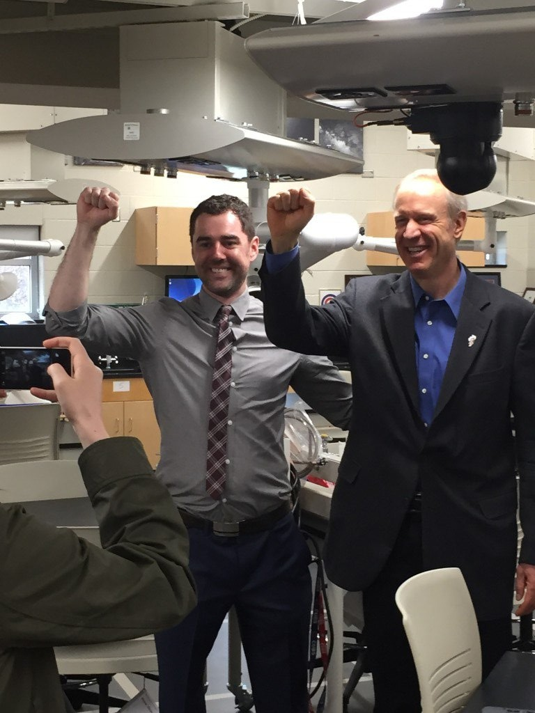 """Governor Rauner and science teacher Christian Ball doing the """"science fist"""""""